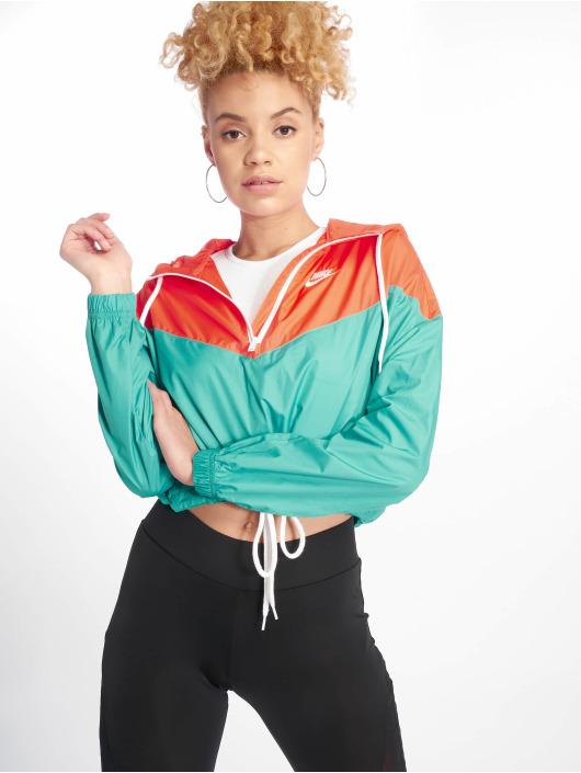 Nike Kurtki przejściowe Windbreaker turkusowy