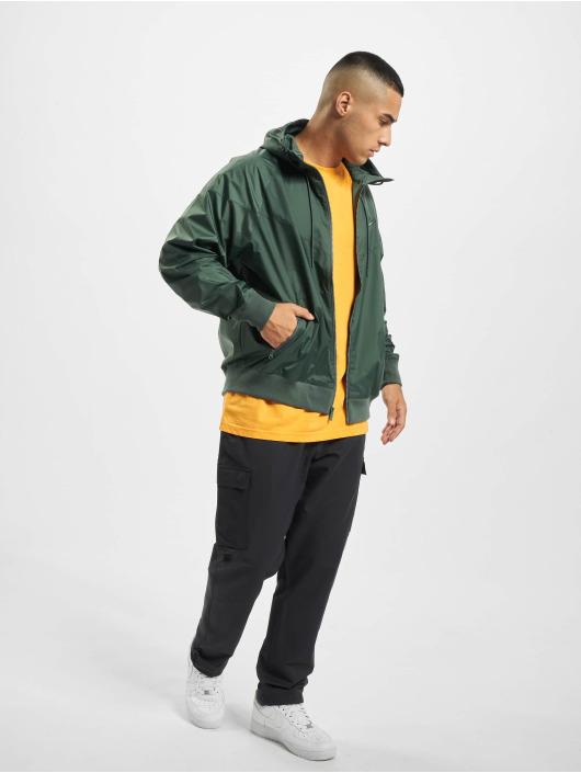 Nike Kurtki przejściowe Windrunner HD zielony