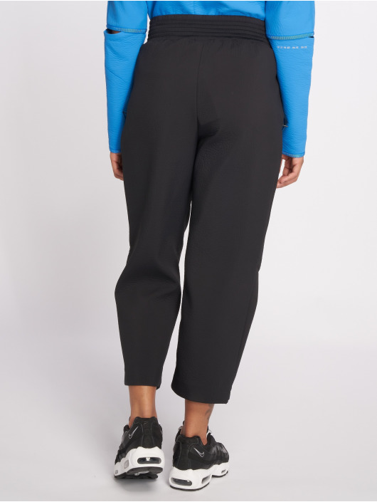 Nike Látkové kalhoty Tech Pack čern