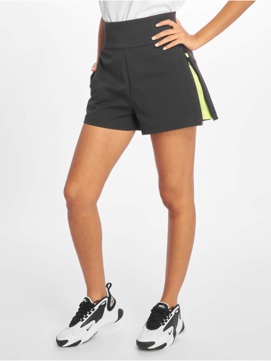 Nike Pantalón cortos TCH PCK Woven gris