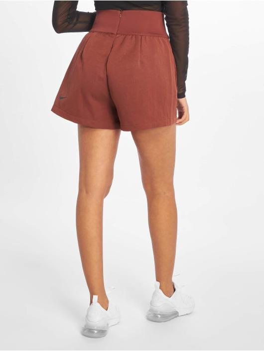 Nike Pantalón cortos TCH PCK Woven marrón
