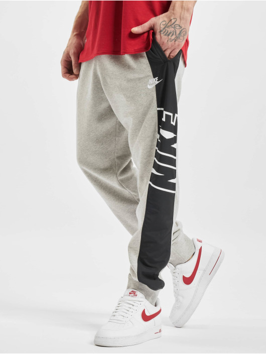 Nike Pantalón deportivo M Nsw Ce Ft Jggr Snl gris