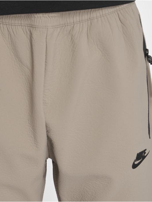Nike Pantalone ginnico Sportswear Tech Pack beige