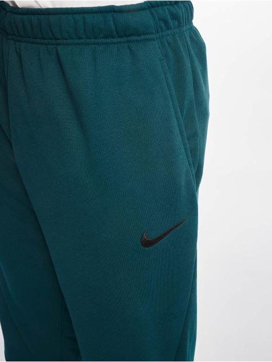 Nike Performance Pantalons de jogging Dry Taper Fleece bleu