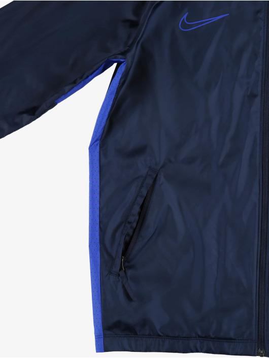 Nike Performance Prechodné vetrovky Dry Academy modrá