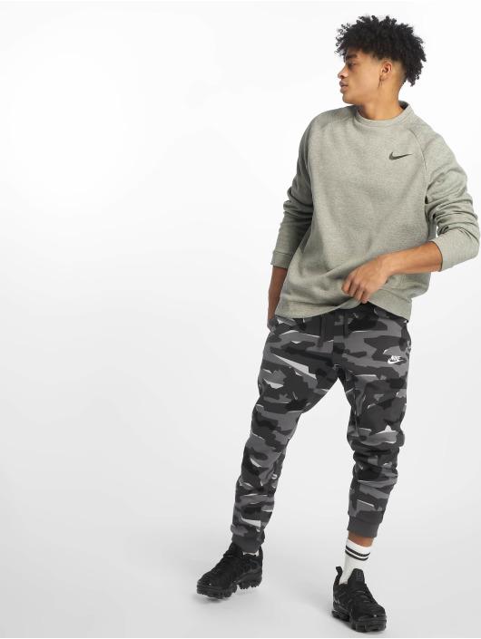 Nike Performance Urheilu T-paidat Therma harmaa
