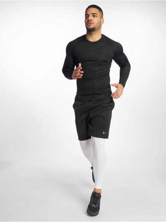 Nike Performance Urheilushortsit Therma 9IN musta