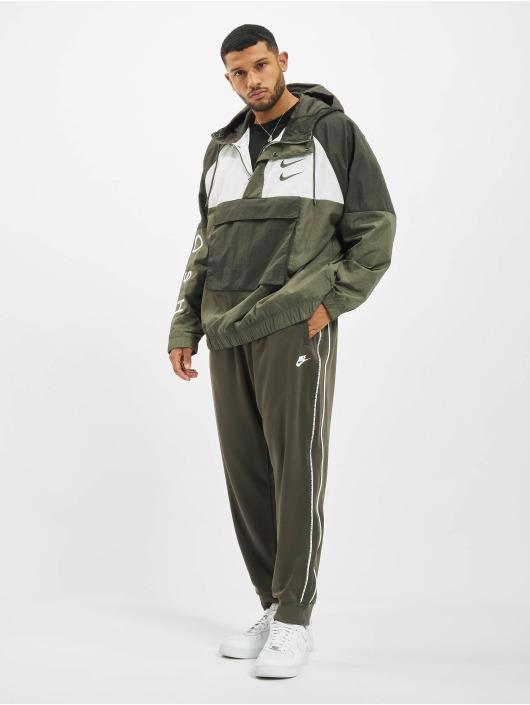 Nike Prechodné vetrovky Swoosh Woven zelená