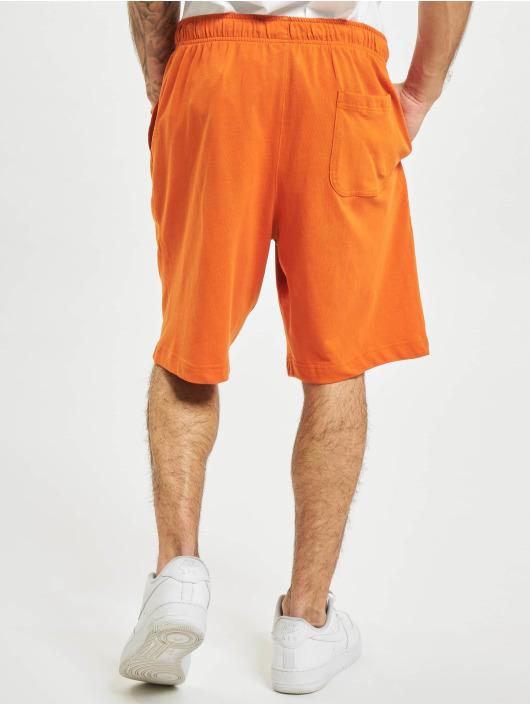 Nike Shortsit Club oranssi
