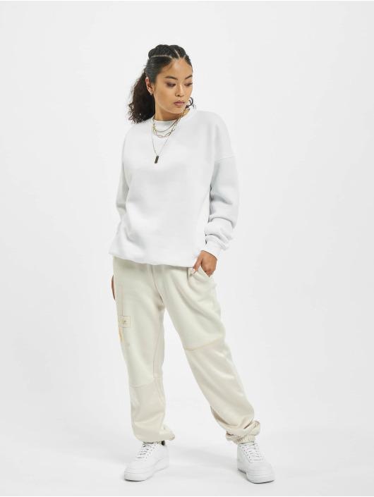 Nike Spodnie do joggingu Icon Clash Fleece bezowy