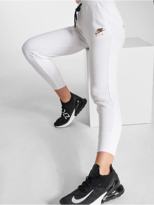 Nike Spodnie do joggingu Rally bialy