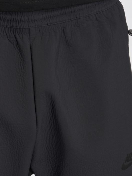Nike Spodnie do joggingu Sportswear Tech Pack czarny