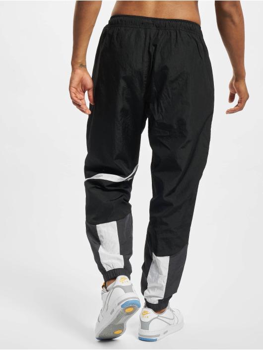 Nike Spodnie do joggingu Swoosh czarny