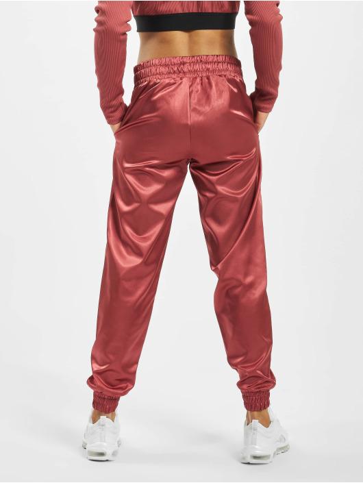 Nike Spodnie do joggingu Air czerwony