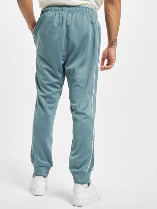 Nike Spodnie do joggingu Repeat PK niebieski