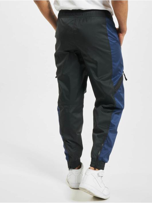 Nike Spodnie do joggingu M Nsw Air Lnd Wvn niebieski