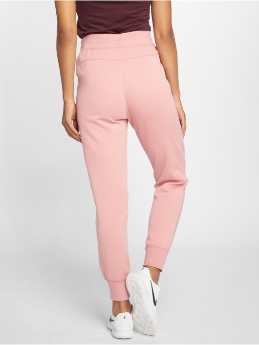 Nike Spodnie do joggingu Sportswear Tech Fleece rózowy