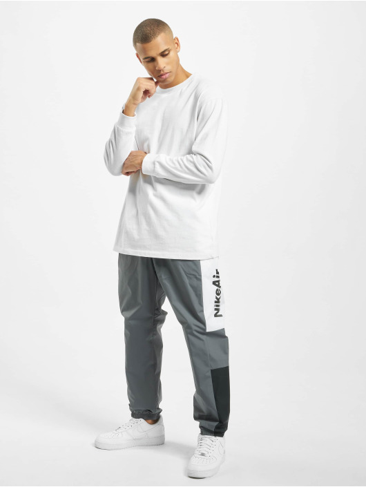 Nike Spodnie do joggingu Air Woven szary