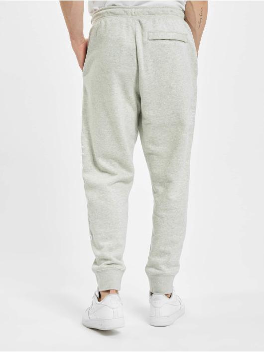 Nike Spodnie do joggingu Swoosh SBB szary