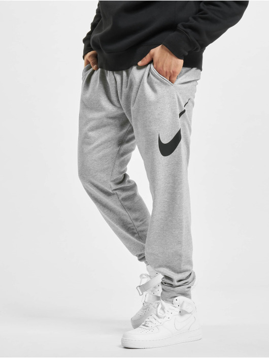 Nike Spodnie do joggingu DF Taper FA Swoosh szary