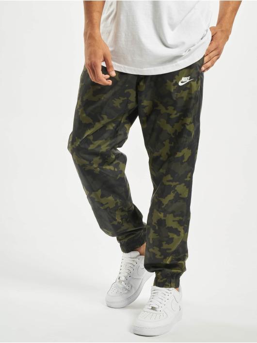 Nike Spodnie do joggingu CE CF Woven Camo zielony