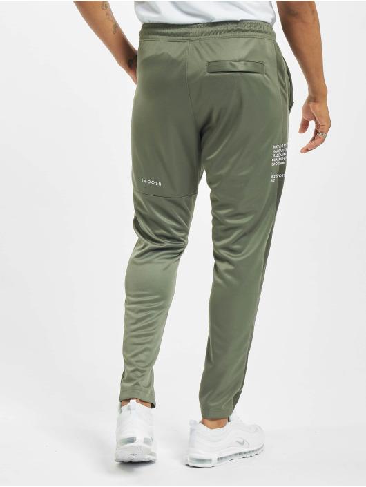 Nike Spodnie do joggingu Swoosh PK zielony