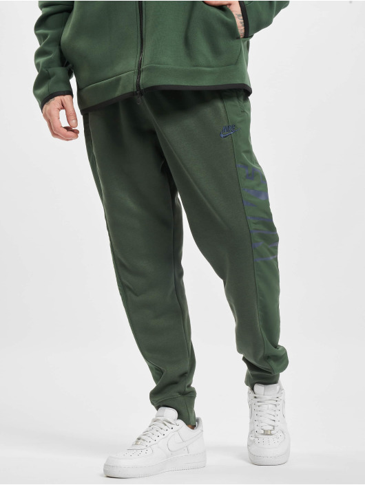 Nike Spodnie do joggingu M Nsw Ce Ft Jggr Snl zielony