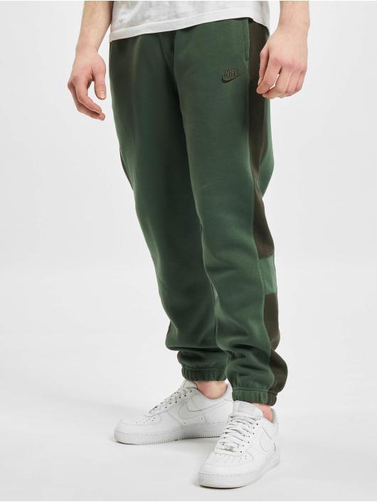 Nike Spodnie do joggingu M Nsw Bb Jggr Snl Cb zielony