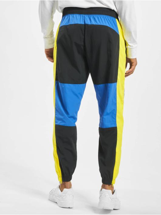 Nike tepláky Re-Issue Woven èierna