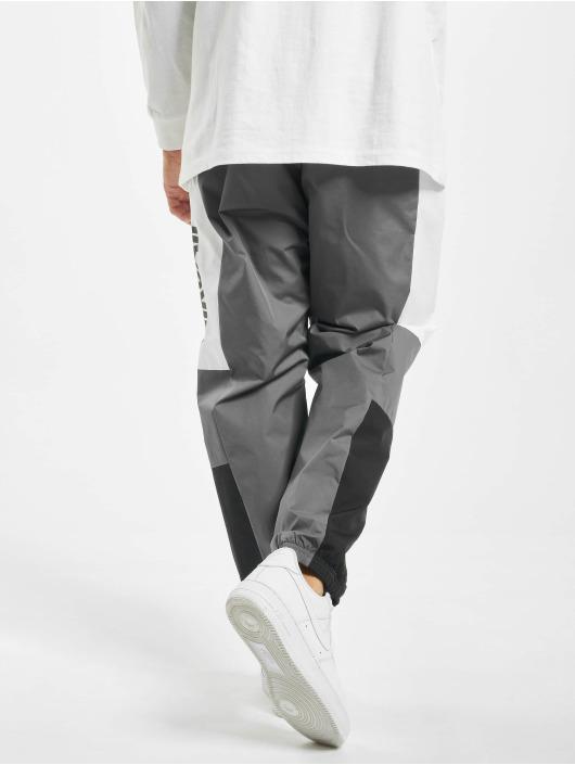 Nike tepláky Air Woven šedá