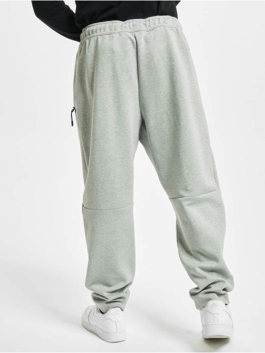 Nike tepláky Tech Fleece šedá