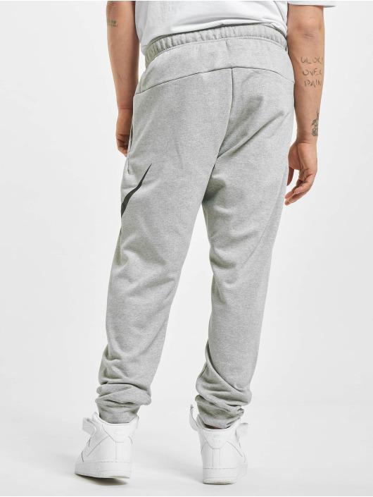 Nike tepláky DF Taper FA Swoosh šedá