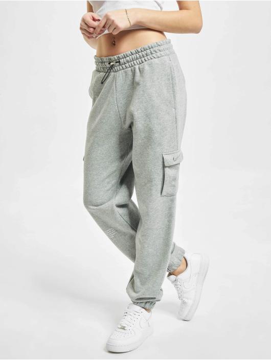 Nike tepláky W Nsw Swsh šedá
