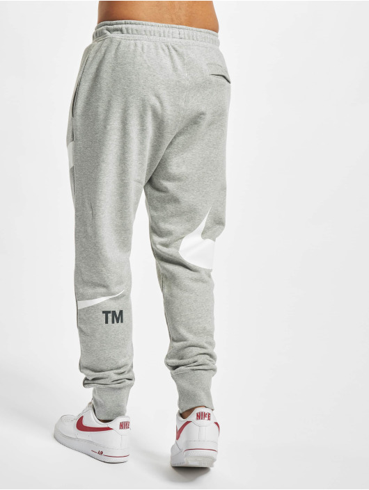 Nike tepláky Swoosh Sbb šedá