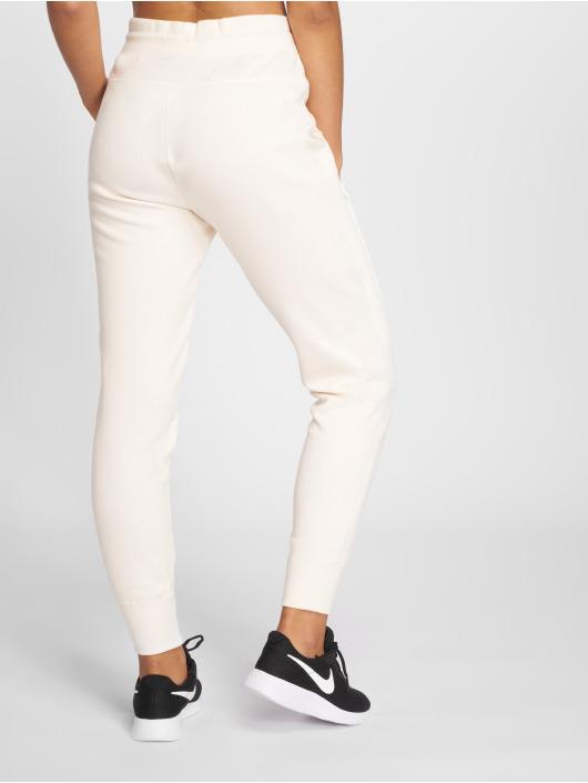 Nike tepláky Sportswear Tech Fleece béžová