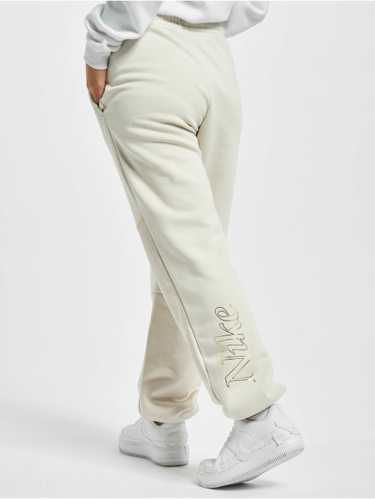 Nike tepláky Icon Clash Fleece béžová