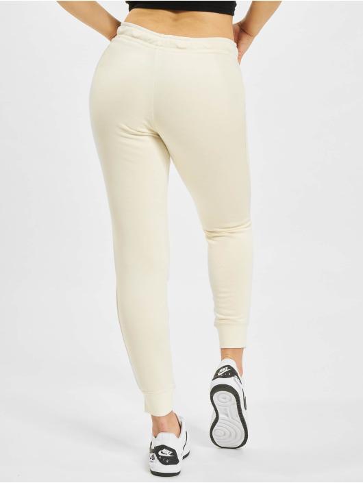Nike tepláky W Nsw Essntl Flc Mr béžová