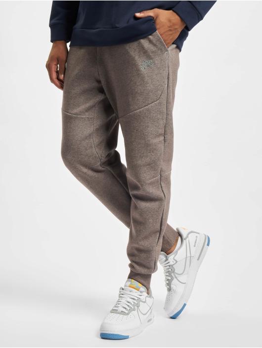 Nike tepláky Nsw Revival hnedá