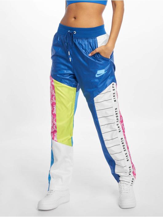 Nike tepláky TRK Woven Pants modrá