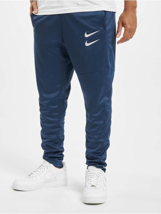 Nike tepláky Swoosh modrá