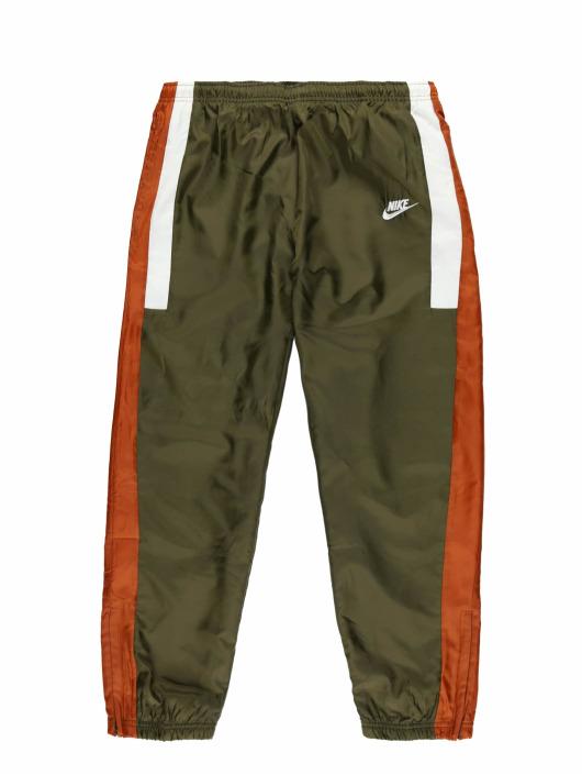 Nike tepláky Sportswear olivová