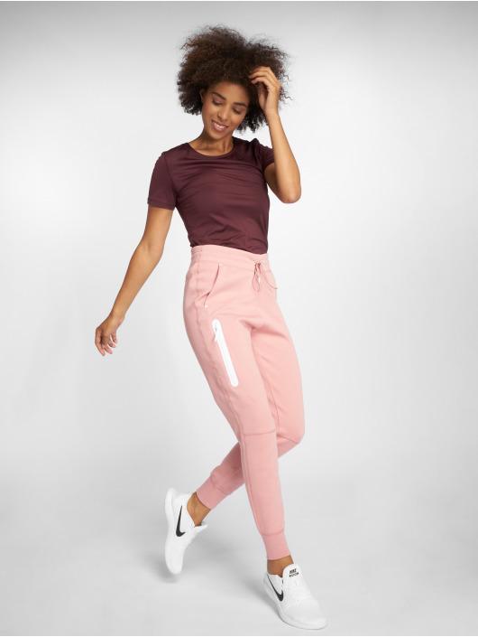 Nike tepláky Sportswear Tech Fleece ružová