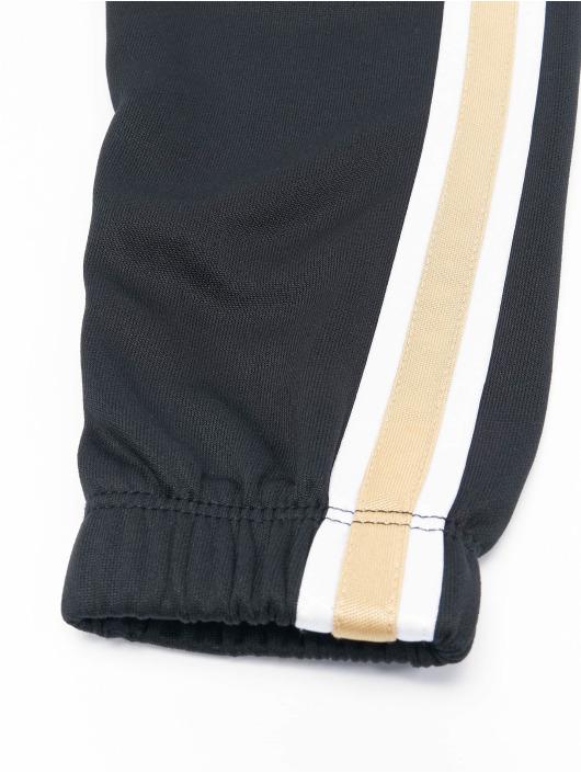 Nike Trainingspak Go For Golden zwart