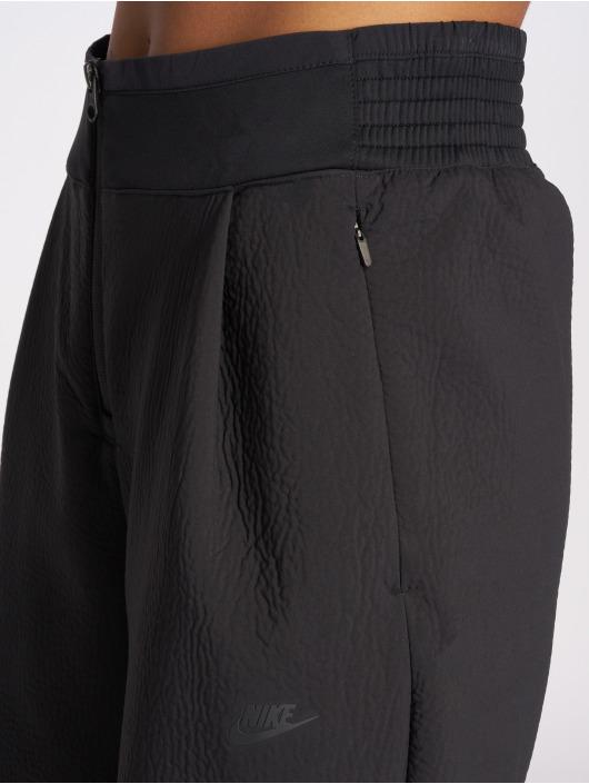 Nike Tygbyxor Tech Pack svart