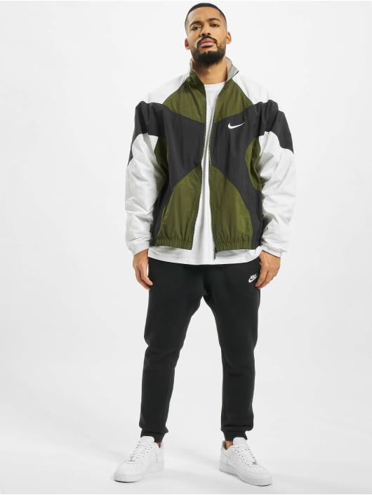 Nike Übergangsjacke Re-Issue Woven grün