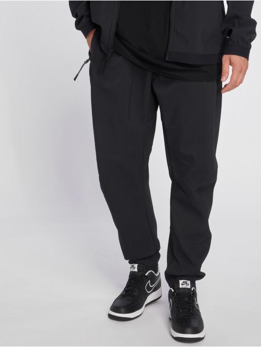 Nike Verryttelyhousut Sportswear Tech Pack musta