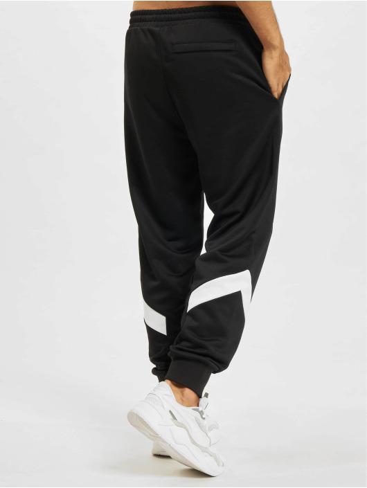 Puma Jogging kalhoty Iconic MCS PT čern