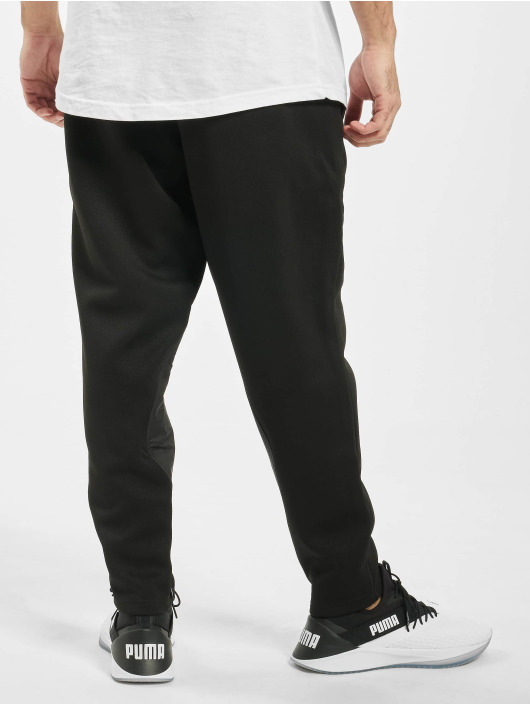 Puma Performance Joggingbyxor Collective Protect svart