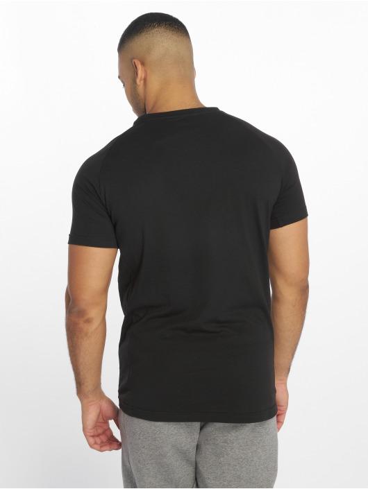 Puma Performance Sportshirts Evostripe Warm czarny