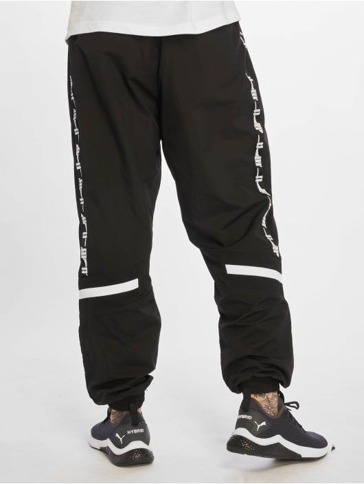 Puma Spodnie do joggingu XTG Woven czarny